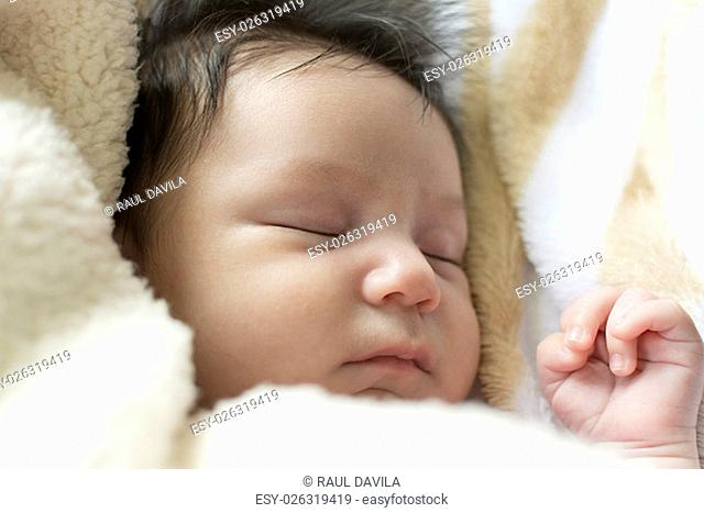 Litlte newborn girl. you can see in detail his right hand, and an expression of calm on his face