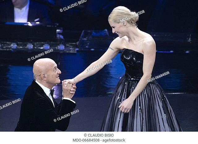 Italian presenter and comic Claudio Bisio and Italian presenter Michelle Hunziker during the second evening of the 69th Sanremo Music Festival