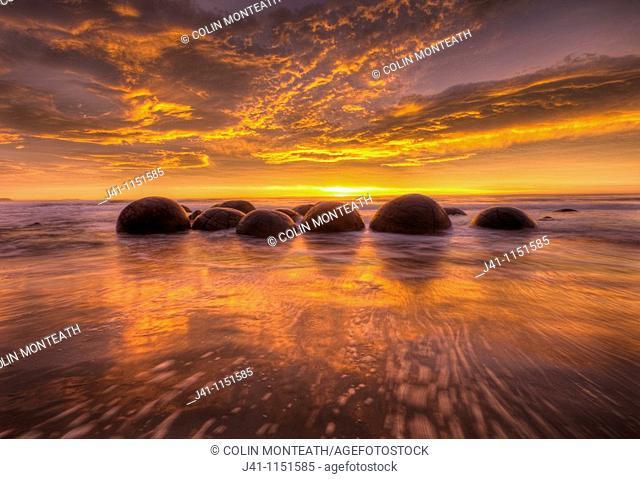 Moeraki boulders at dawn as SW front passes overhead, near Oamaru, Otago