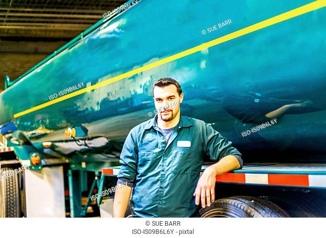 Portrait of young male trucker at biofuel industrial plant