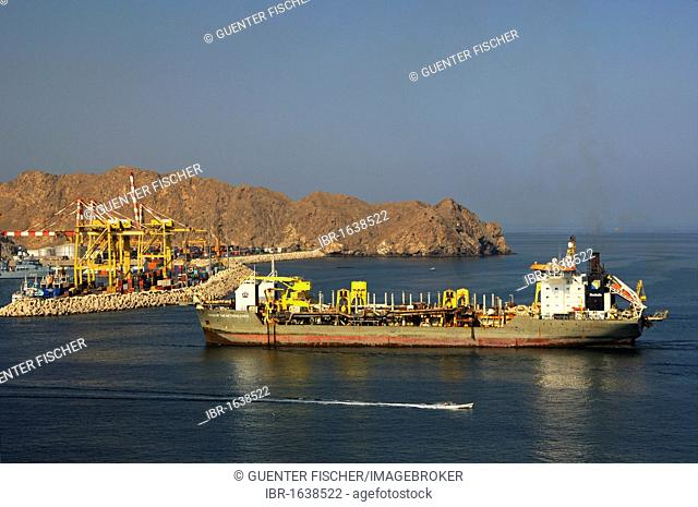 Queen of the Netherlands dredger entering Port Sultan Qaboos, Muscat, Sultanate of Oman, Middle East