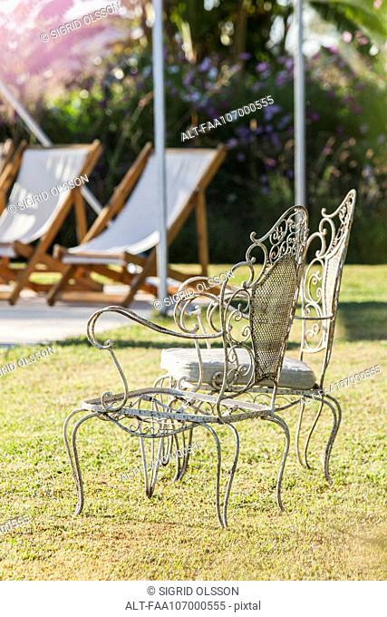 Wrought iron chairs in yard
