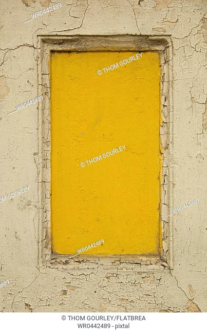 Yellow Boarded Up Window