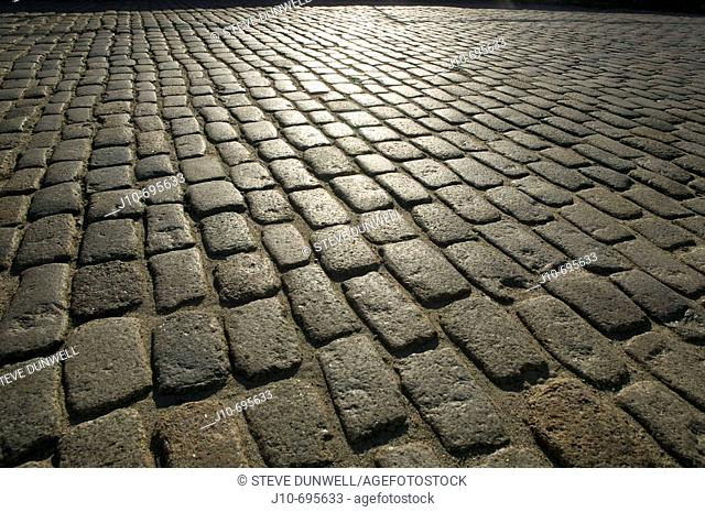 Paving stones with sun reflected, South Boston, MA, USA