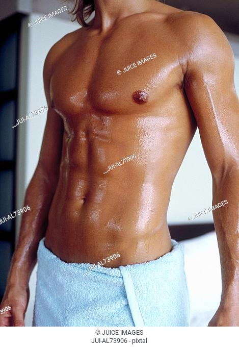 View of a young man's torso just out of the shower