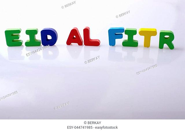 the word EID EL FITR written with colorful letter blocks