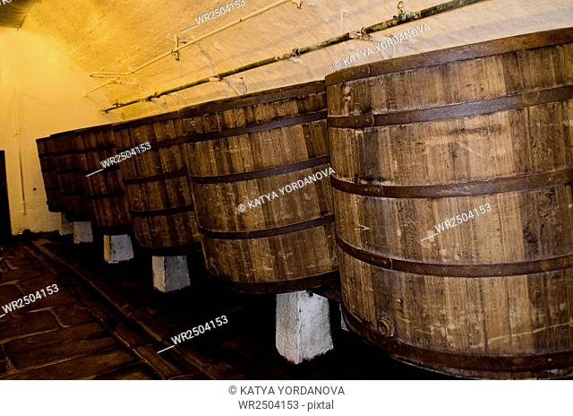 Old wooden barrels in cellars of Pilsner Urquell Brewery
