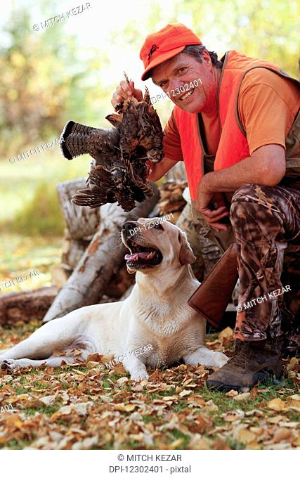 Grouse Hunter After Hunt With Yellow Lab