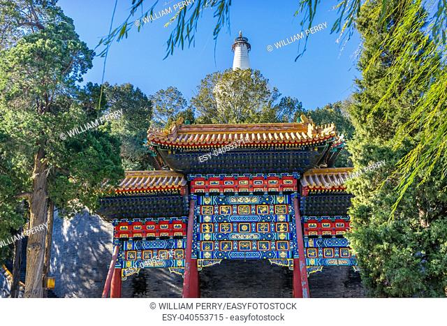 Ornate Red Blue Gate White Pagoda Buddhist Stupa Jade Flower Island Beihai Park Beijing China Beihai created in 1000 AD, Stupa in 1600s.