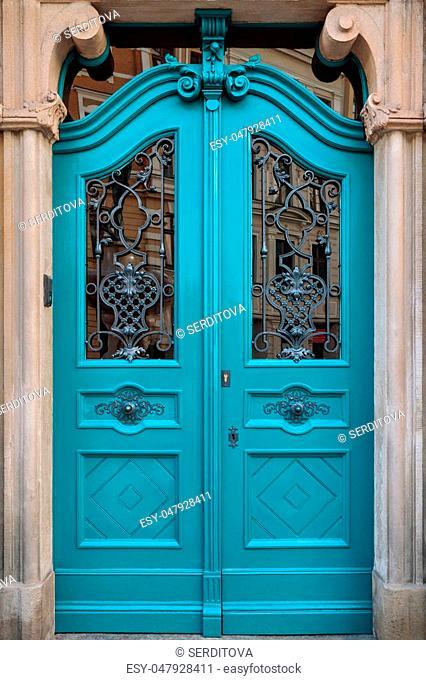 Traditional european vivid facade with entance door