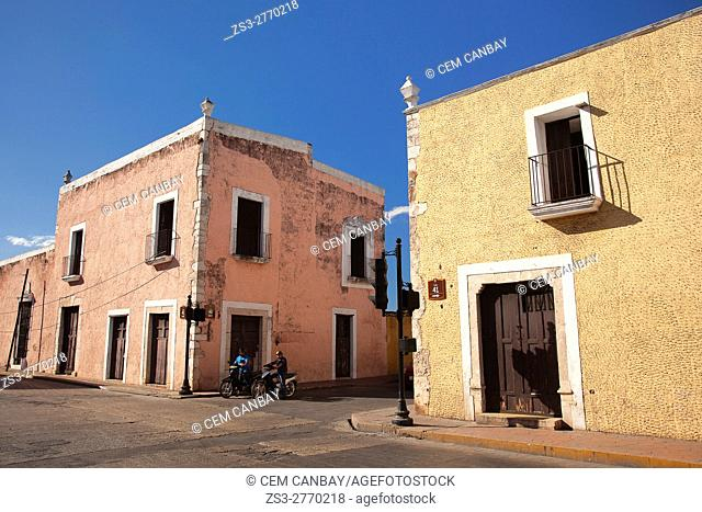 Motorcyclists near the colonial buildings in the town center, Valladolid, Yucatan Province, Mexico, Central America