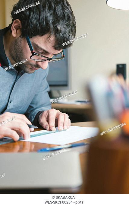 Architect drafting at desk