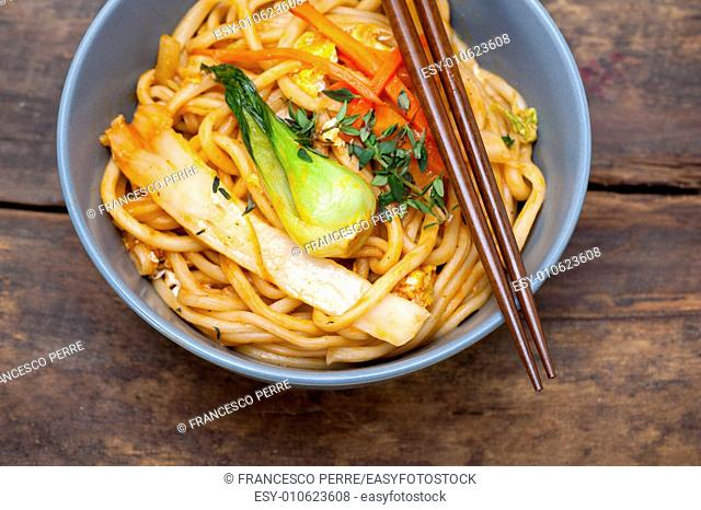 hand pulled stretched Chinese ramen noodles on a bowl with chopstick