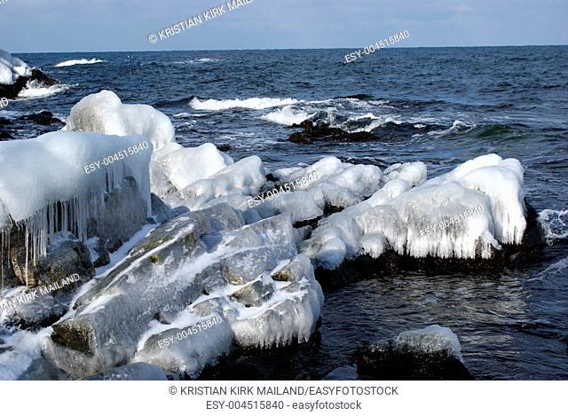 Ice on rocks by the sea. Bornholm, Island in the Baltic Sea
