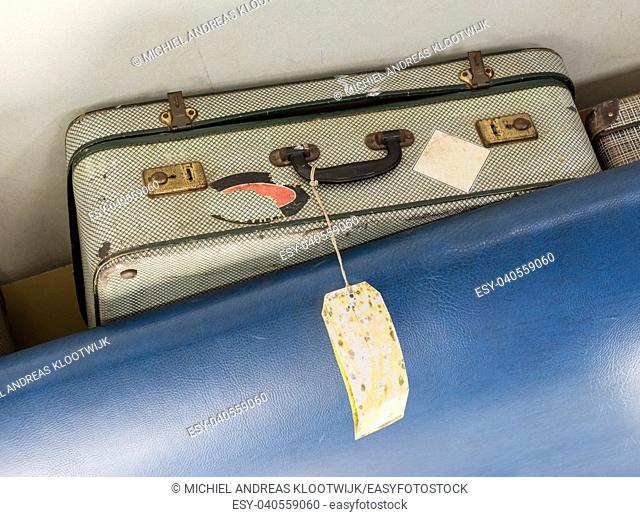 Old suitcase for cabin baggage - Selective focus - Inside an old airplane