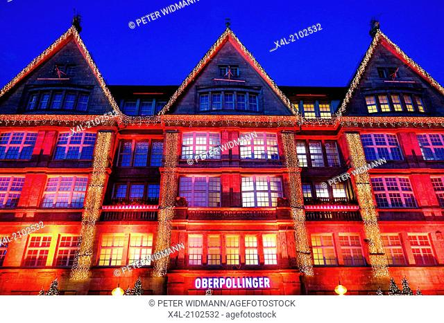 Christmas shopping, colorful illuminated facade of the department store Oberpollinger in the Neuhauser Street in Munich