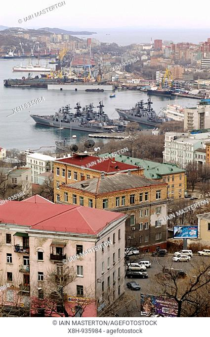View over the city and harbour with naval ships moored in the city of Vladivostok in the far east of Russia