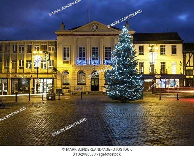 Christmas Tree in the Market Place in front of the City Hall at Dusk Ripon North Yorkshire England