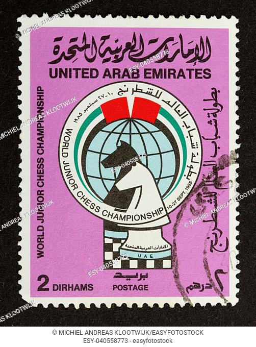 UNITED ARAB EMIRATES - CIRCA 1980: Stamp printed in the UAE shows two chesspieces, circa 1980
