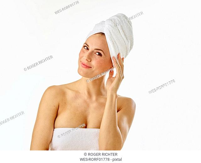 Young woman with towel on her head