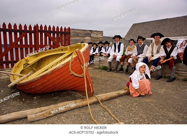 Children and their carers look on during the public punishment of a fisherman for stealing a bottle of wine at the Fortress of Louisbourg