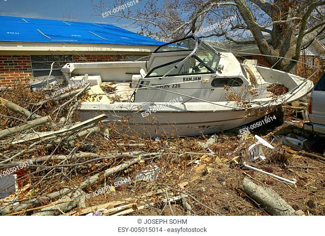 Ram Jam boat and debris in front of house heavily hit by Hurricane Ivan in Pensacola Florida