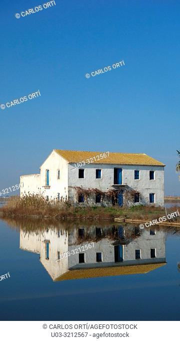 Old rural house in a rice field. La Albufera Natural Park, near Valencia city, Spain, Europe