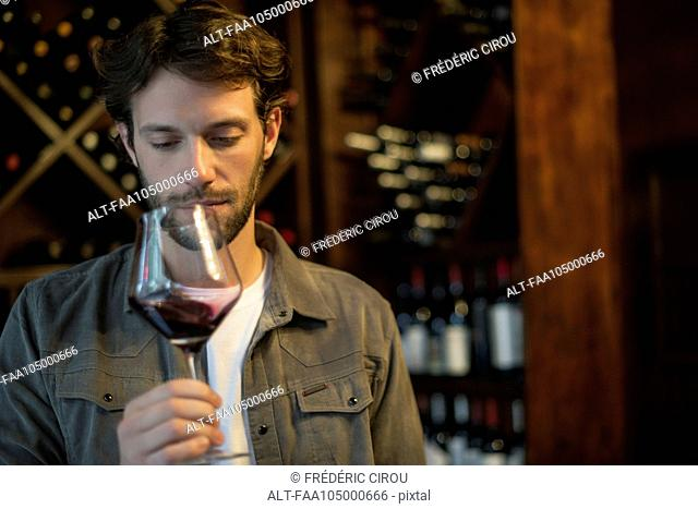 Sommelier evaluating quality of glass of wine