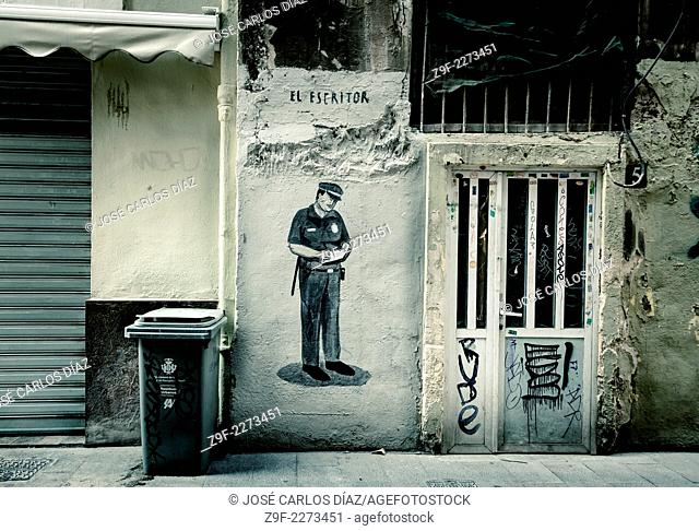 Police writing ticket, graffiti, Valencia, Spain
