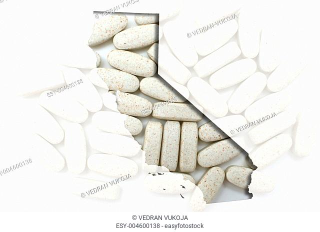 Outline California map of with transparent pills in the backgrou