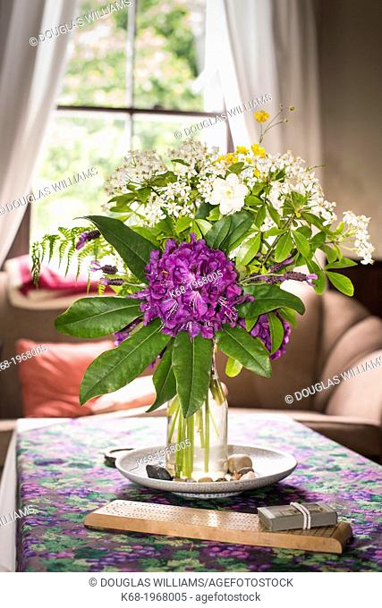 Flowers in a vase in a living room on Saturna Island, Gulf Islands, British Columbia, Canada