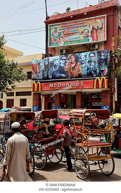 Rickshaws in front of the McDonald's restaurant in the Chandni Chowk Market in Old Delhi, India. Chandni Chowk is Asia's largest wholesale market