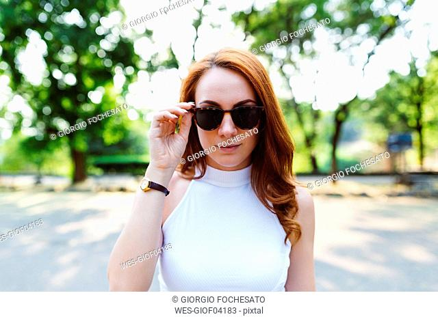 Portrait of redheaded woman wearing sunglasses