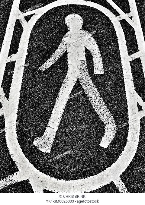 Footpath sign painted on tarmac UK