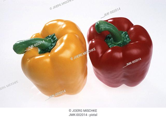 A red and a yellow paprika
