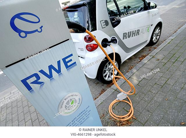 GERMANY, ESSEN, 23.07.2014, DEU , GERMANY : A Smart car of Ruhrauto-e car sharing company is parking at a charging station of RWE in Essen for recharge - Essen