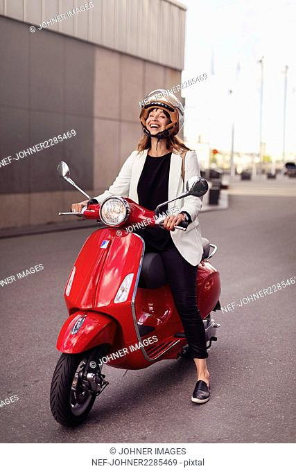 Happy woman on scooter