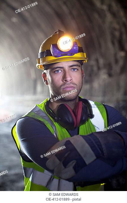 Worker standing in tunnel