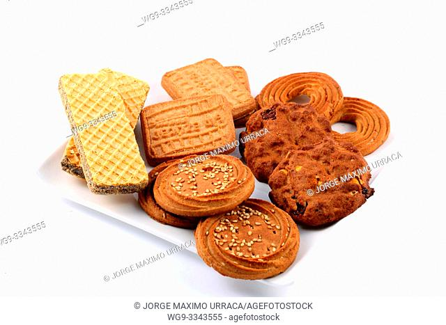 Assorted cookies on a white plate with white background