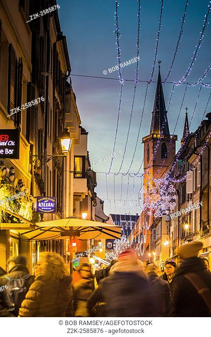 People walking in Grand Rue street in Strasbourg street at the time of Christmas in december 2015
