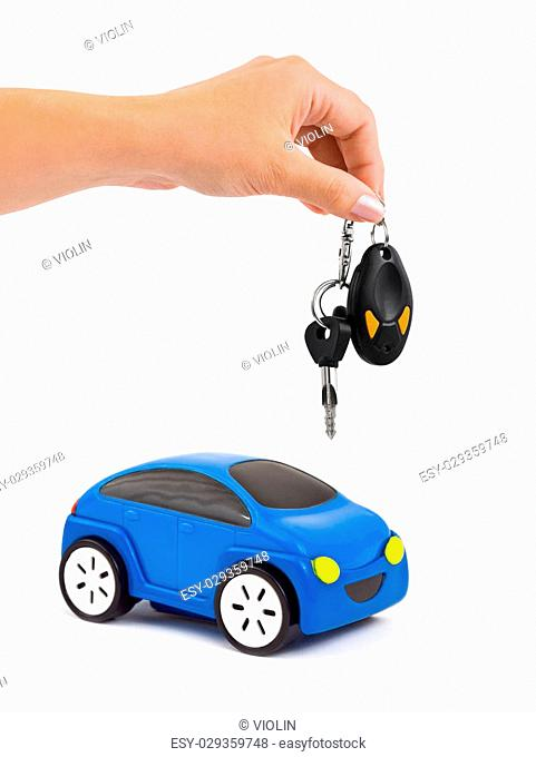 Hand with keys and car isolated on white background