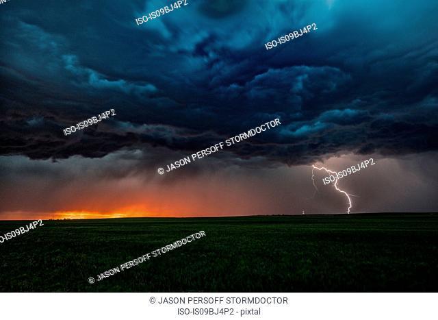 Asperatus clouds in sunset and cloud-to-ground lightning bolt, Ogallala, Nebraska, US