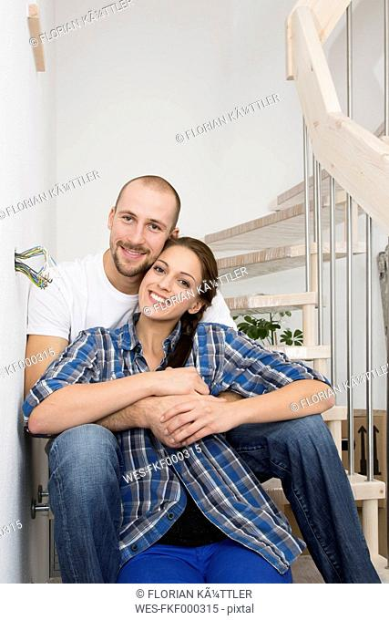Happy young couple in new home