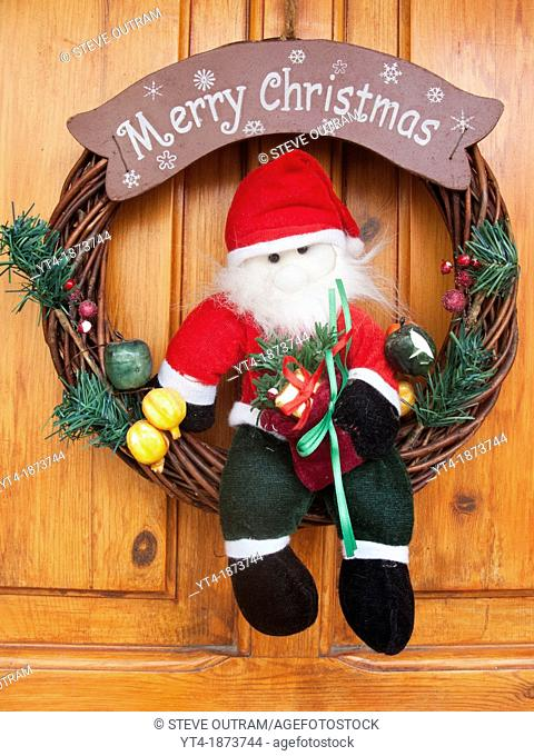 Merry Christmas Santa Claus Decoration on House Door, Crete, Greece