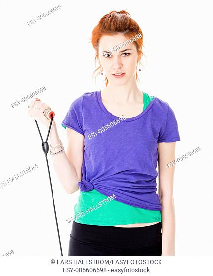 Studio portrait of attractive young woman training with rubber band
