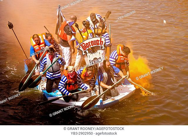 Lewes Bonfire Societies Take Part In The Annual 'Bonfire Dash' On The River Ouse In Aid Of Local Charities. The Participants In Home Made Rafts Are...