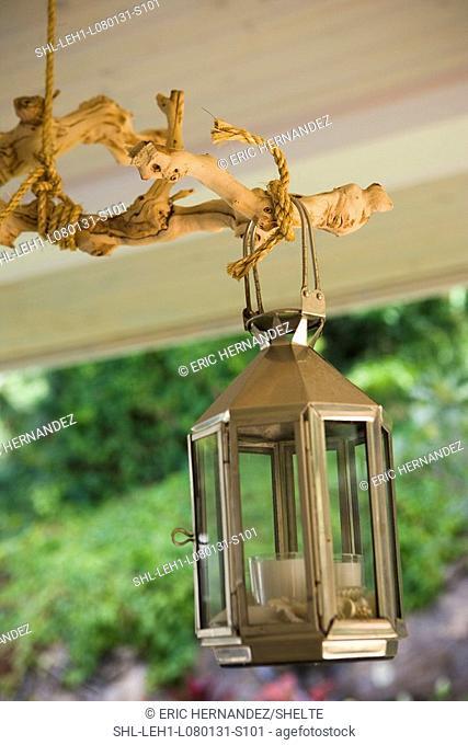 Detail outdoor lantern on driftwood