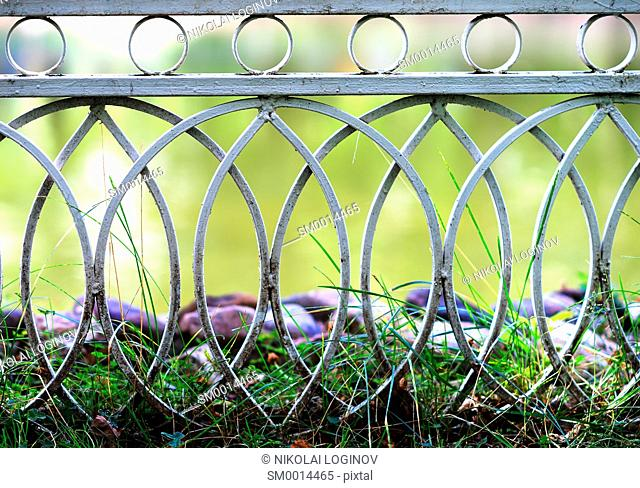 Curved park fence bokeh background hd