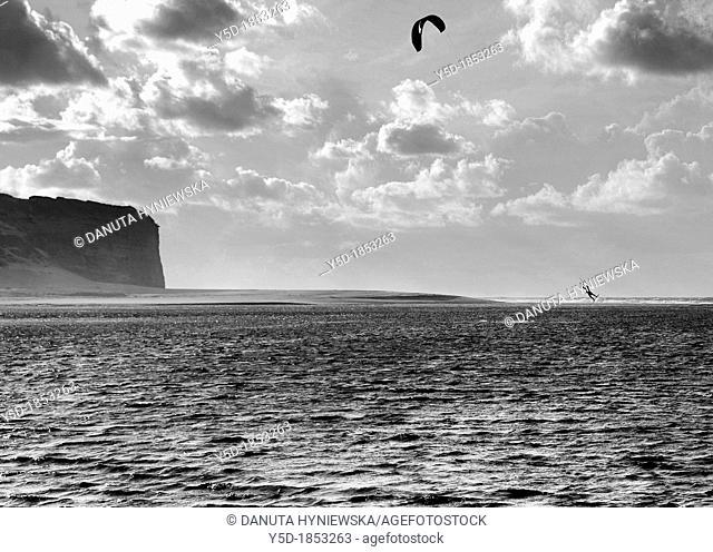 lonely kitesurfer flying over Obidos Lagoon next to Atlantic Ocean in Foz do Arelho, Silver Coast, Costa Prata, Portugal