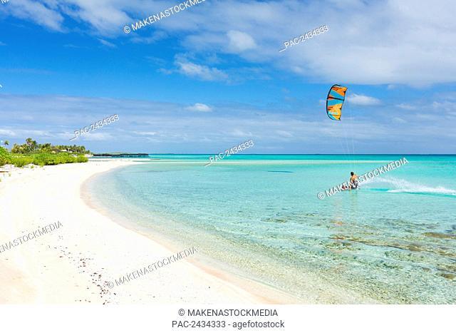 Kiteboarding in tropical lagoon in the South Pacific; Tikehau, French Polynesia